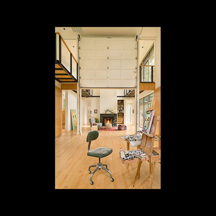 The finished home is just 19-feet wide and oriented along a north-west access. The studio, shown here with the living room in the background, is situated at the northern most end of the house to take advantage of the soft, natural light that pours in the