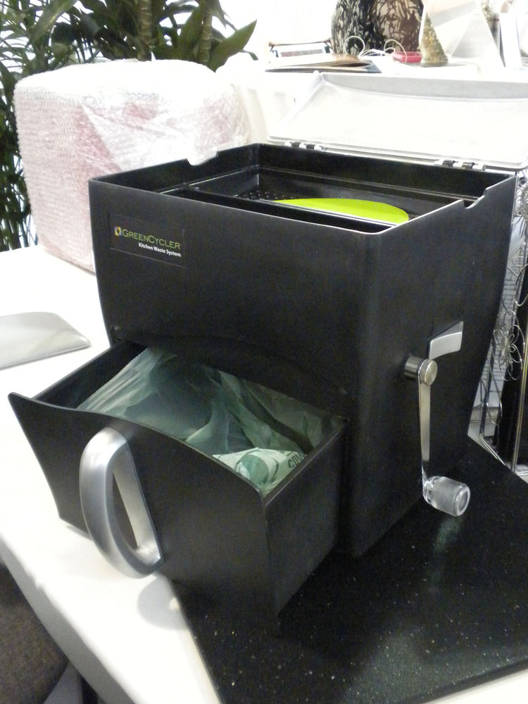 """Also on display was the <a href=""""http://thegreencycler.com/"""">GreenCycler</a> a new product that is just now accepting pre-orders. The countertop container holds up to three gallons of compost in its pull-out bottom bin, with which you can line with a comp"""