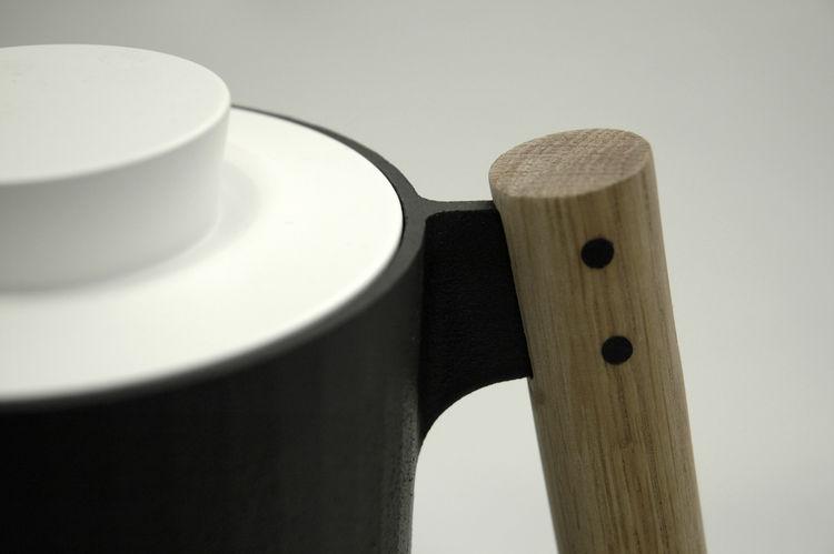 """The """"dowel handle,"""" the trio writes, """"provides an ergonomic powergrip while contributing to the concept of cookware as 'tools.'"""""""