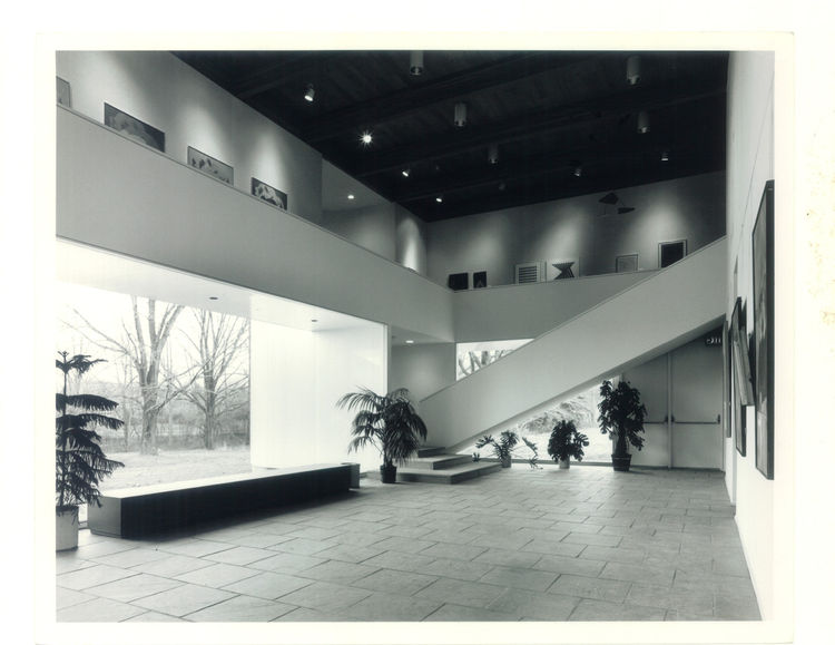 The lobby of the Mansfield Art Center in Mansfield, OH, from 1971 is all about geometry. The white space makes a fine home for the words of art, and the plants on the ground floor add to the serenity of the interior. Photo courtesy of Thom Abel.<br /><br