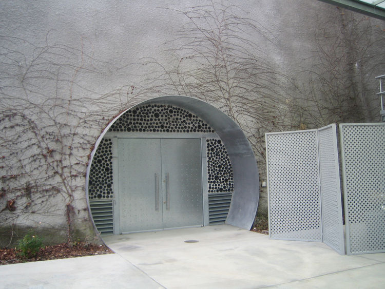 There are two entrances to the underground cave. Each has this circular portal with heavy-bottomed wine bottles surrounding the door.