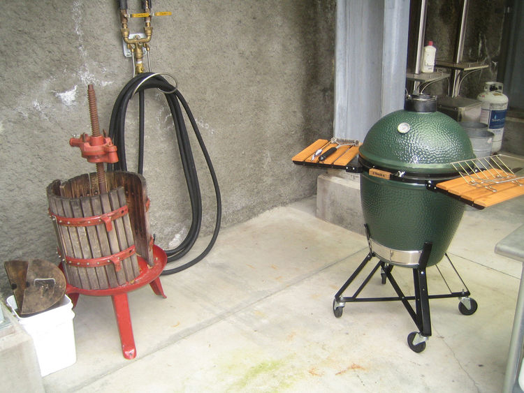 I couldn't resist this juxtaposition of the space-age Big Green Egg cooker and the very old-school wine press.
