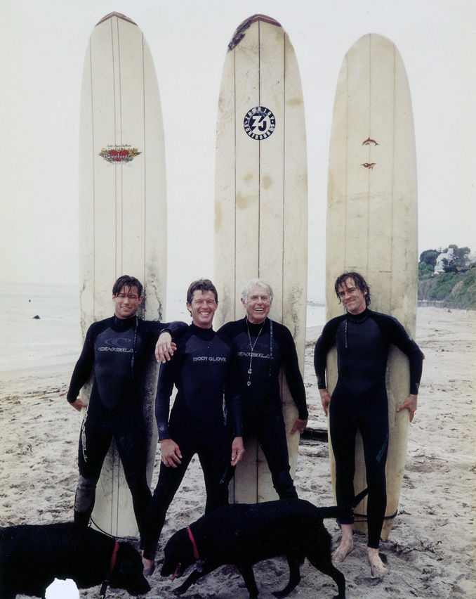 Gesner on the beach with his sons, late 1990s. From left: Zen, Jake, Gesner, and stepson Casey Dolan.<br /><br /> Credit: Courtesy of Harry Gesner