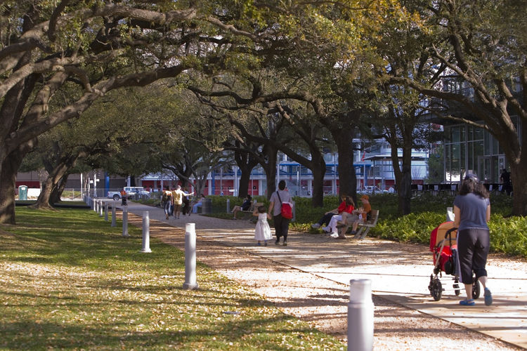 In addition to walking paths, Houston's downtown park Discovery Green offers an array of activities, from free yoga and Pilates classes to concerts and performances to a playground for kids and a man-made pond for steering electric boats. Visit Discovery