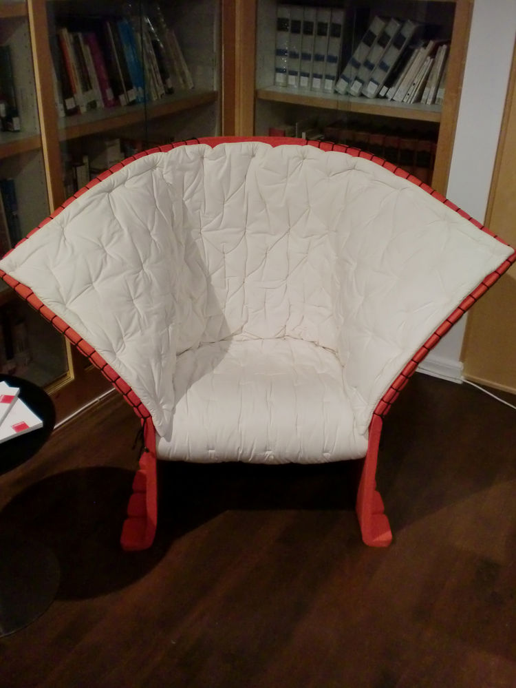 The current production model of the I Feltri chair, a 1985 design evoking both the artist Joseph Beuys' use of felt, and Japanese origami.