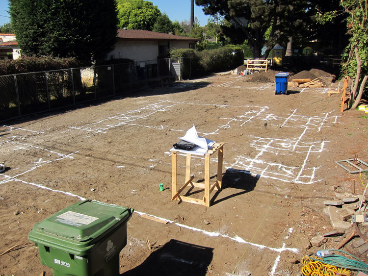 The outlines of footings are marked on the ground. This is the first 1:1 scale layout of the home, which makes for an interesting walk around the site