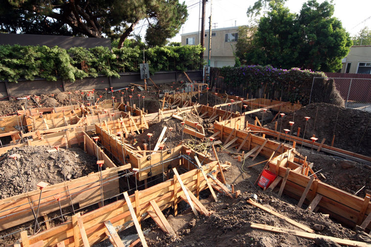 Forms and rebar ready for concrete footing pour at the rear area of the house including garage and master bedroom.
