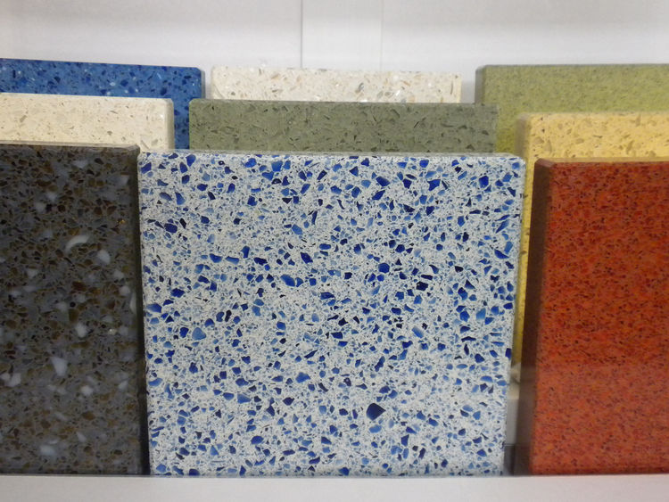 """Also displaying recycled-glass surfaces was <a href=""""http://www.icestone.biz/"""">IceStone</a>. The blue color in its line comes from recycled Skyy Vodka bottles."""