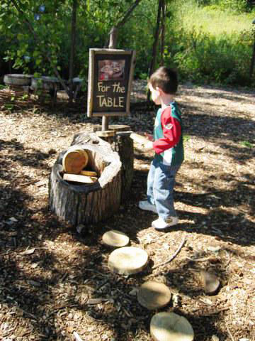 "<h3>Step 8:  Include Loose Parts</h3>  Your child will, of course, make their own additions to the natural playscape. ""Tree cookies""—sanded slices of logs—are a natural playground classic and easy to make on your own. They can be stacked and counted, laid"