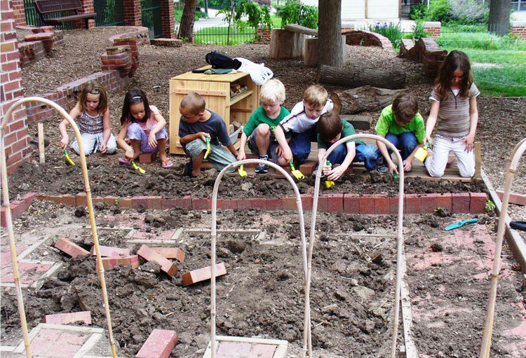 Returning to my own childhood, what I played with most (next to the hill) was a pile of bricks left over from the construction of my family's home. Bring loose parts into your natural playscape for endless hours of building.<br /><br />Image courtesy of <