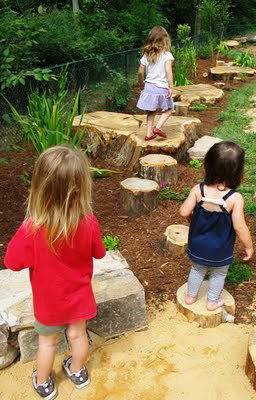 <h3>Step 5: Make a Path</h3> Children love to follow a path. Use stepping stones, or bricks, or large rocks or slabs cut from a tree trunk to weave even a short trail through your grasses or along your hill.<br /><br />Image courtesy of Paul Horne at <a h