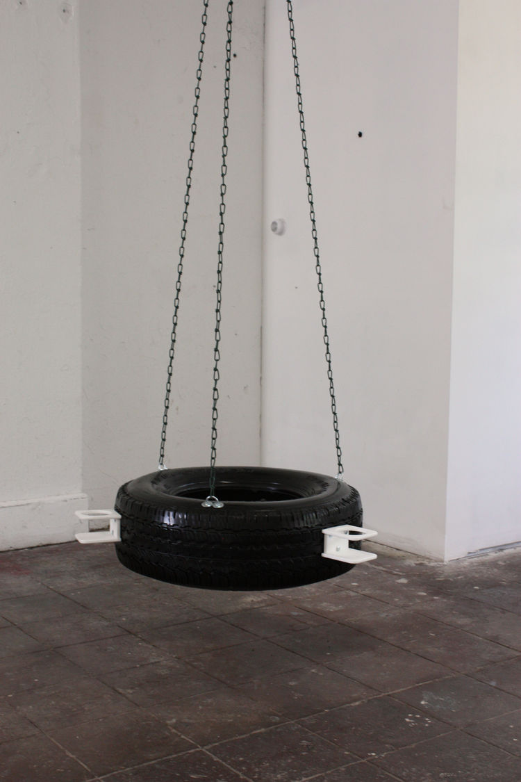 Artist Patrick McDonough's work, entitled 100907 Tire Swing is just that. Here's the Washington-based artist's statement: At first glance, it's just a tire swing, but outfitted with motorboat cup holders and customized with black enamel, it's an interacti