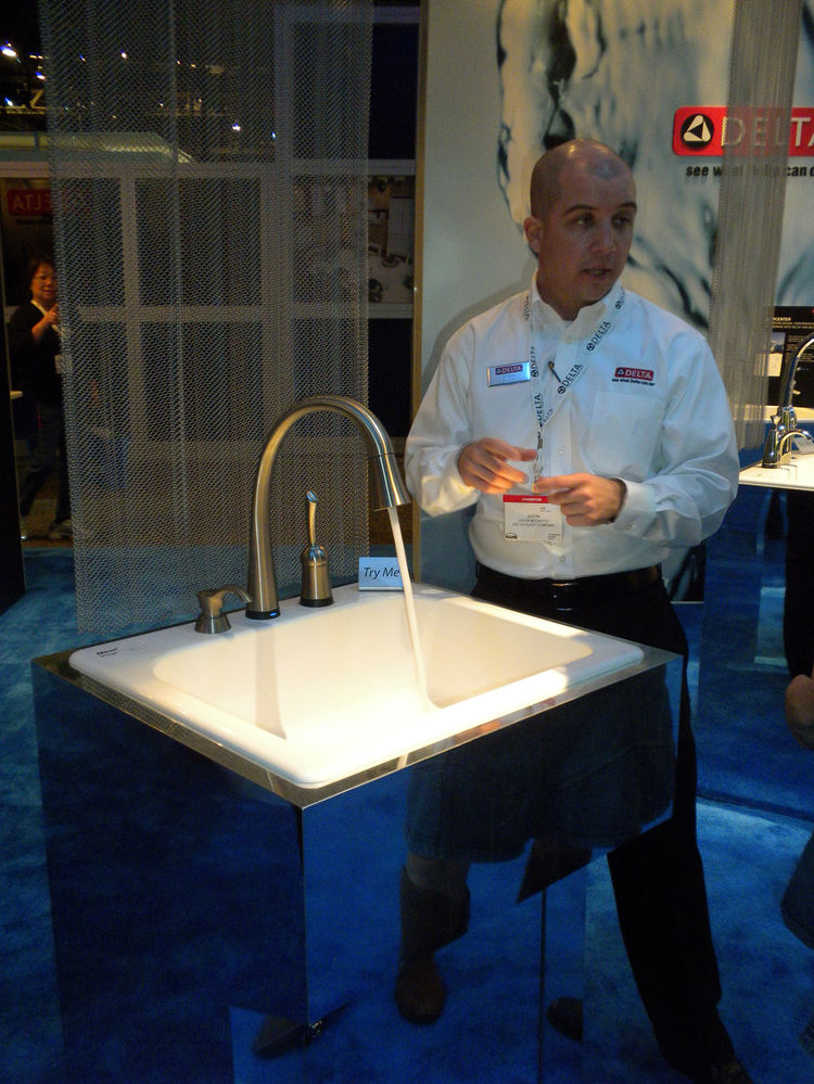 """<a href=""""http://www.deltafaucet.com/"""">Delta Faucets</a> was showing off its popular <a href=""""http://www.deltafaucet.com/kitchen/details/980T-SSSD-DST.html"""">Pilar faucet</a>, more commonly known as """"the touch sink."""" It was fun to try it out in person: The"""