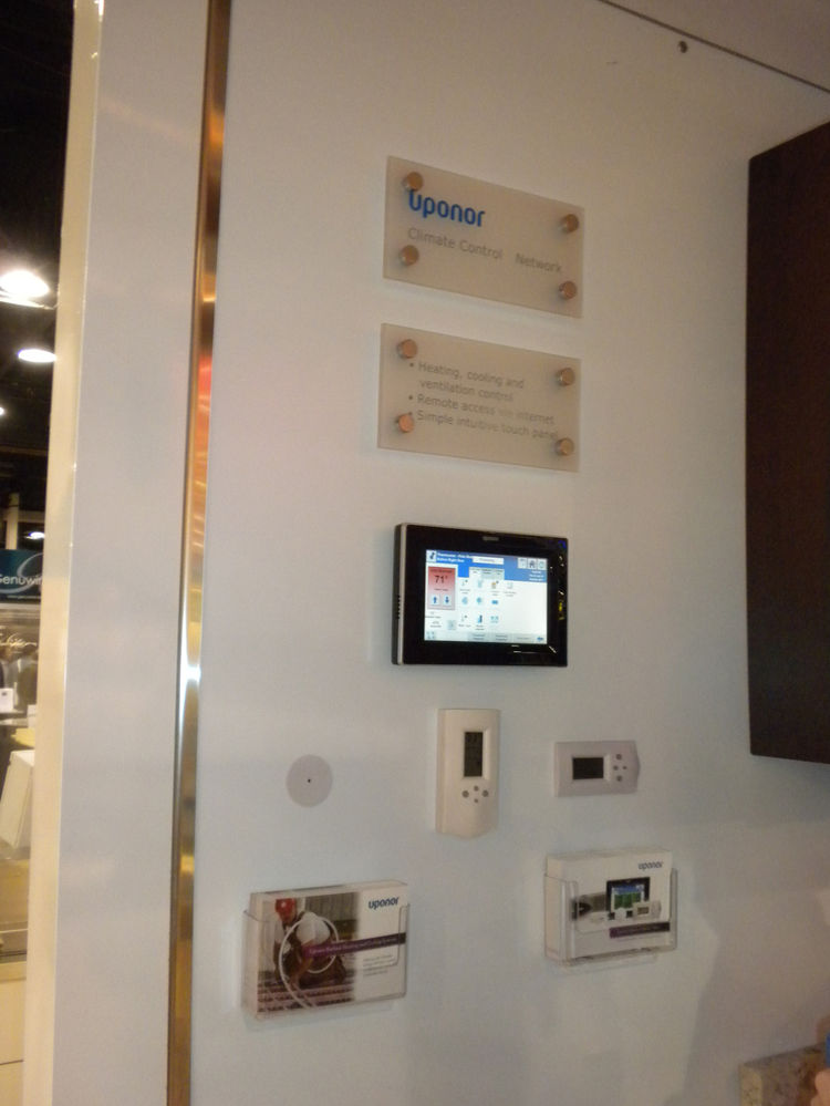 """<a href=""""http://www.uponor-usa.com/"""">Uponor</a> had a great booth that highlighted and explained the many home technologies and products it produces, including radiant flooring, energy-saving hot water systems, overhead sprinklers, and electronic home mon"""