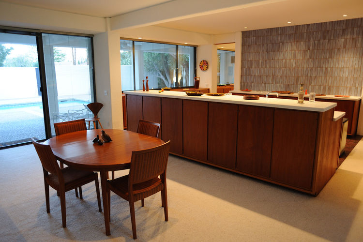Here's the dining table that sits front and center. The mid-century vibe is very strong in this house despite its late 70s design. The dark wood certainly helps that. The whole place feels like a groovy fantasia in teak.