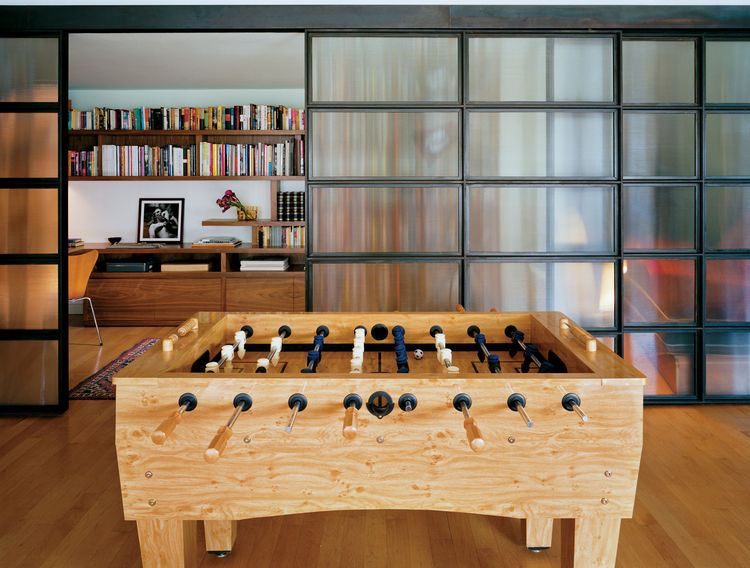 """Outside the foosball table reigns. All the more reason to shut the doors when curling up with a good book. Photograph by <a href=""""http://www.warcholphotography.com/"""">Paul Warchol</a>."""