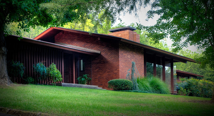 Rich red bricks and vertical lines define the exterior of Jone's Wilkinson/Lechtenburger residence first built as a spec house in 1956. Photo by Don Shreve