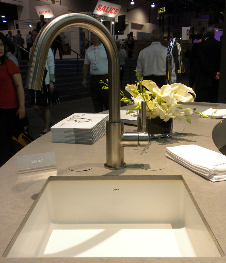 """<a href=""""http://www.brizo.com/"""">Brizo</a> showed its Solna kitchen faucet that featured a hidden pull-down faucet head. The company's swan-inspired Vuelo kitchen collection and art deco Charlotte bath collection was also on view and will be available this"""