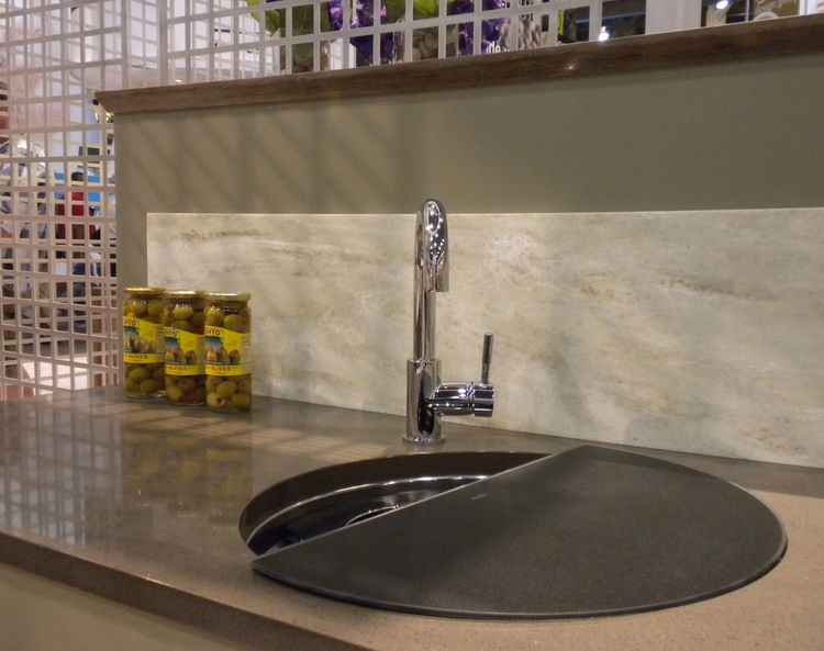 """Another vignette in the Dupont booth featured the company's Zodiaq surface in Sage. The sink is one of my favorites from <a href=""""http://www.blancoamerica.com/c3/blanco_usa/_www/en/pub/index.cfm"""">Blanco</a>, which includes a cutting board with a colander"""