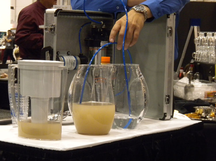 "Few things draw a crowd like a demonstration. <a href=""http://www.everpure.com/Pages/default.htm"">Everpure</a> showed the differing results of running dirty water through a standard pitcher filter versus through the Everpure undercounter filtration system"