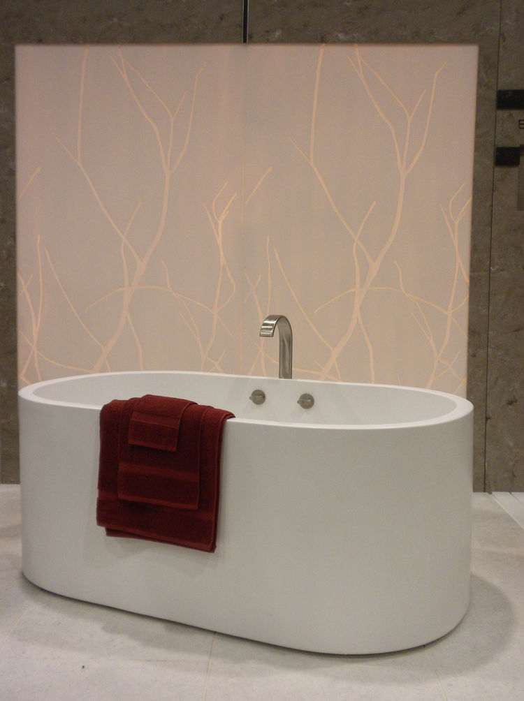 "<a href=""http://www.himacs.eu/home"">LG Hausys</a> (whose name comes from ""haus systems"") showed its line of quartz and acrylics. Here, its HI-MACS surface is displayed as a backlit wall panel and also as a freestanding tub."