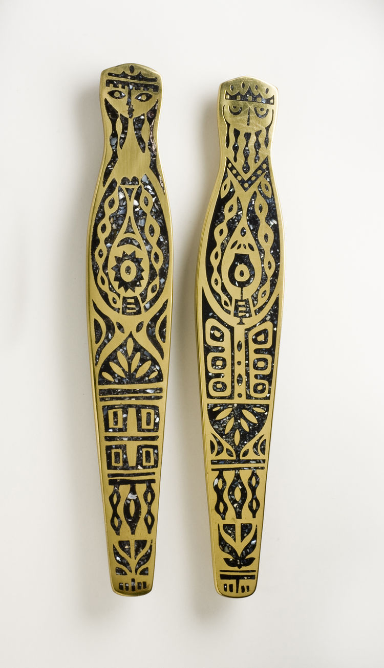 <i>King and Queen Door Pulls</i>, hand-cast brass with black mother-of-pearl inlay, Evelyn Ackerman, 1959.