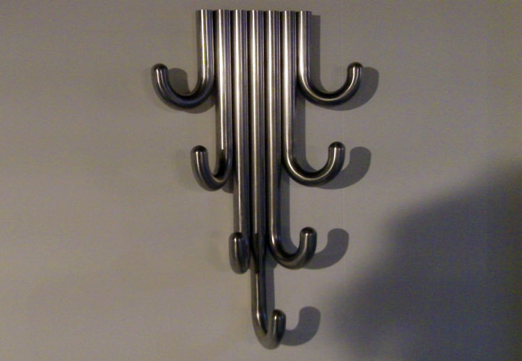 Also at Designjunction, Australian Marcel Sigel seemingly mixed comic book and Arts & Crafts jewelry to produce the Wall Brooch coat rack.
