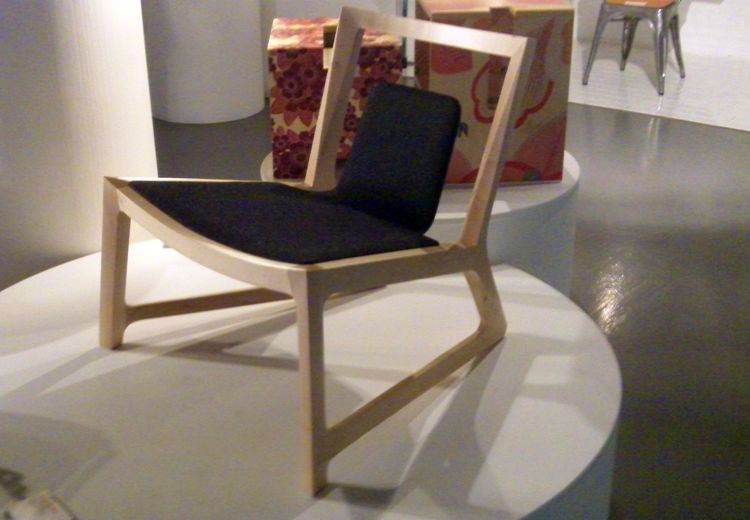At Designjunction, Australian Jon Goulder of Midland Atelier showed the low-slung Amore Mio chair with a cut-out backrest and feet that taper from front to back.