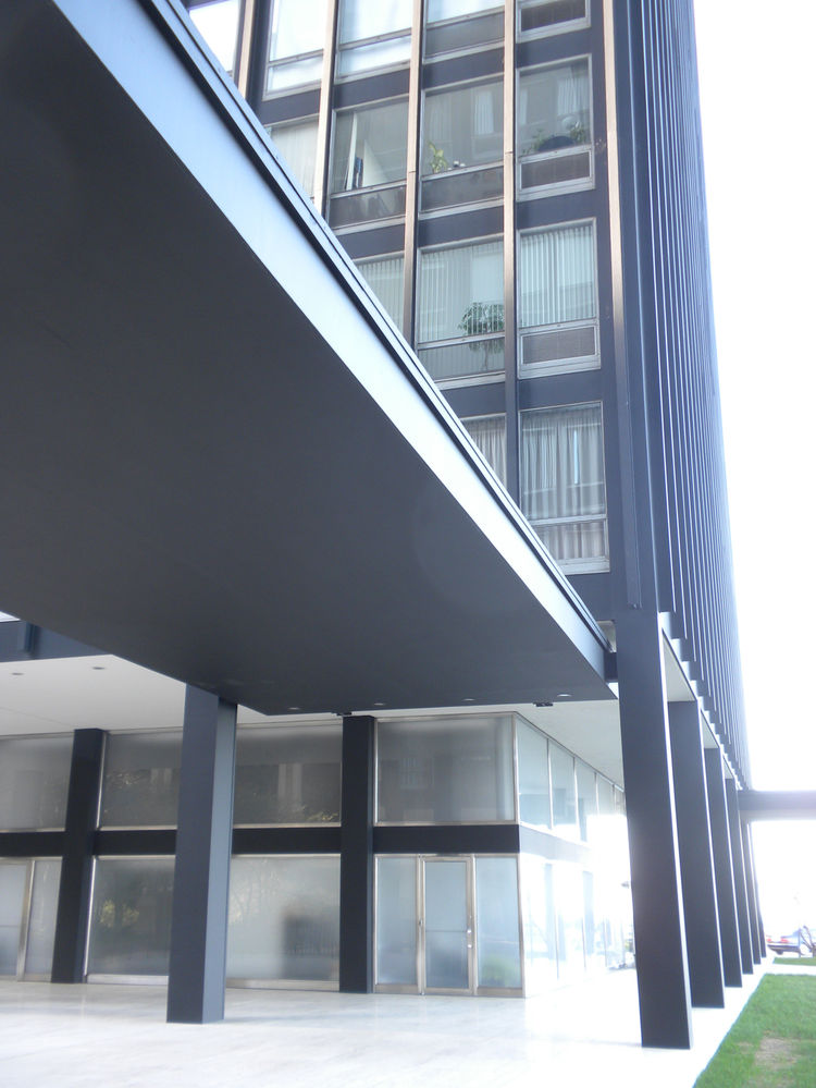 The view from the east side of the courtyard to the 880 tower, with hints of the apartment interiors through the above windows.