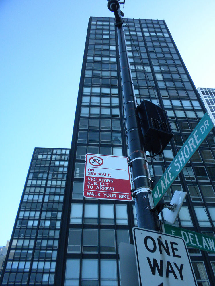 """Near the base with the """"N. Lake Shore Dr."""" street sign in view."""