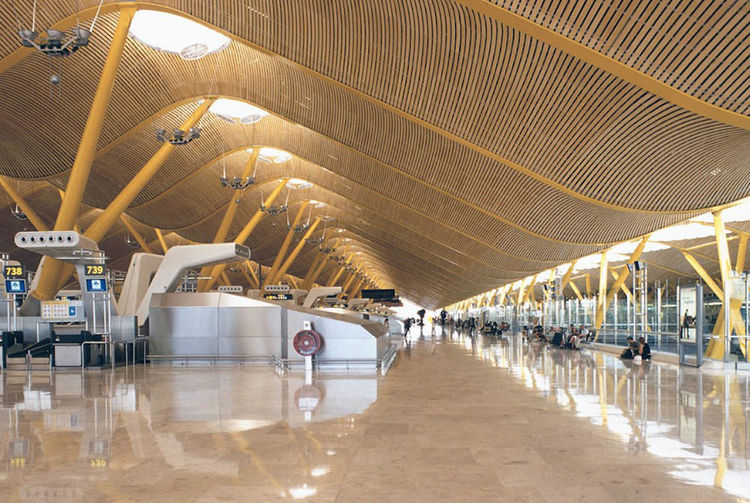 The Barajas Airport extension in Madrid by architect Richard Rogers is perhaps the architect's greatest addition to Spanish design. The undulating roof is supported by branching concrete columns.
