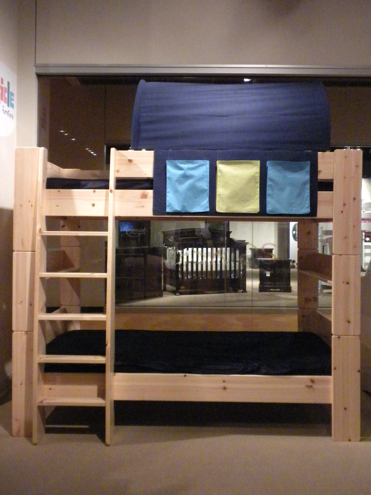Shown here is Popsicle Furniture's HighSleeper, configured with two twin beds and a spacer along with its Cave topper.