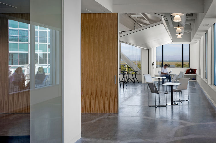 """The new space features offices surrounded by 15 """"living rooms"""" designed to promote collaboration and interaction among employees. Shown here is the cafeteria."""