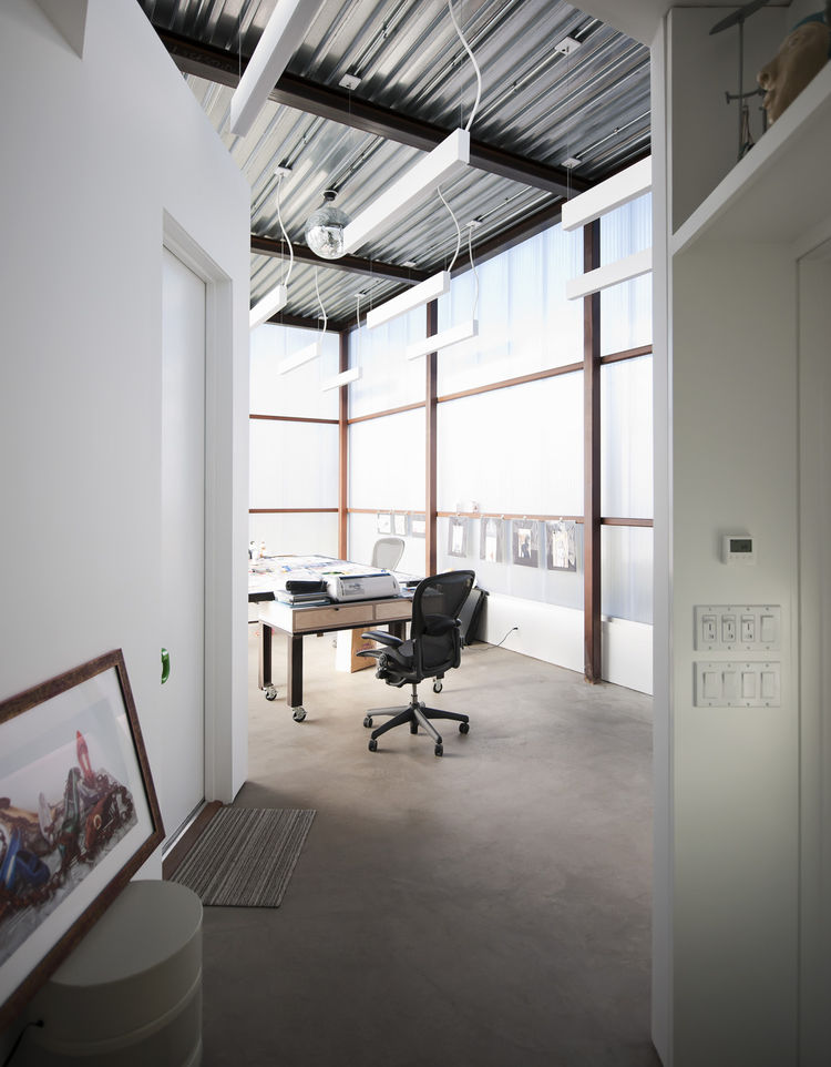 The shift in materials from polycarbonate sheeting to drywall indicates the change of programming. The ceramics studio, equipped with a kiln and the necessary tools for mixing colors, is much more closed off to the exterior with its drywall construction b