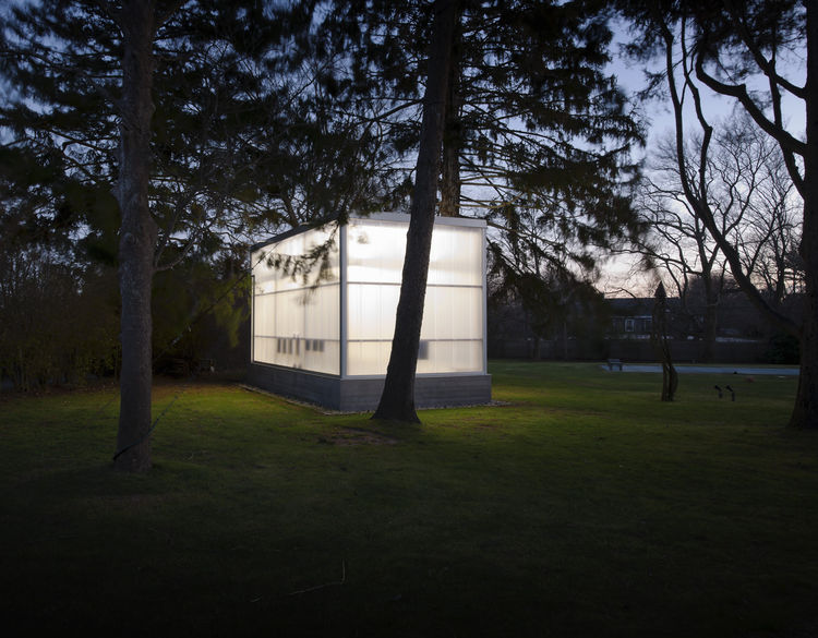 """Completed in 2009, the studio shines in the night among the trees. Weiselberg and Semaan devised a clever foundation system that allowed them to avoid ripping up roots. """"The floor is a concrete slab on a steel deck that sits on a spider web of steel beams"""