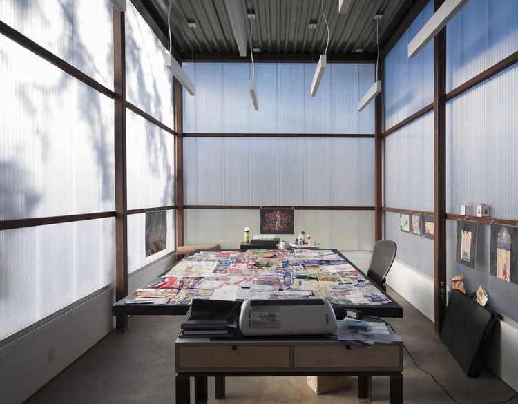 """Inside the collage studio, light floods in from outside. """"He didn't want to be able to necessarily see the outside but he wanted it to be very bright,"""" Semaan says. """"From the inside, you can't make out exactly what's out there but you can see some of the"""