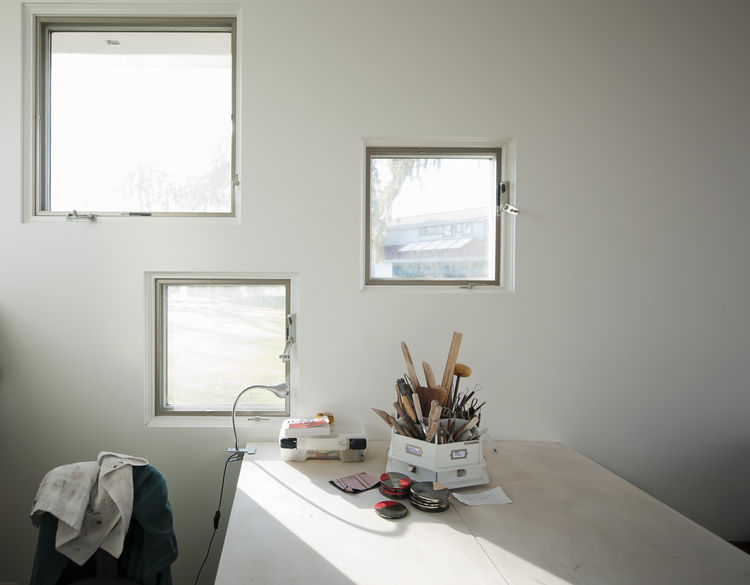 The client wavered back and forth between making her space a ceramics studio or a personal gym, in the end choosing the studio. The square windows frame views of the home and were carefully positioned so that the lowest window is at eye level when the cli