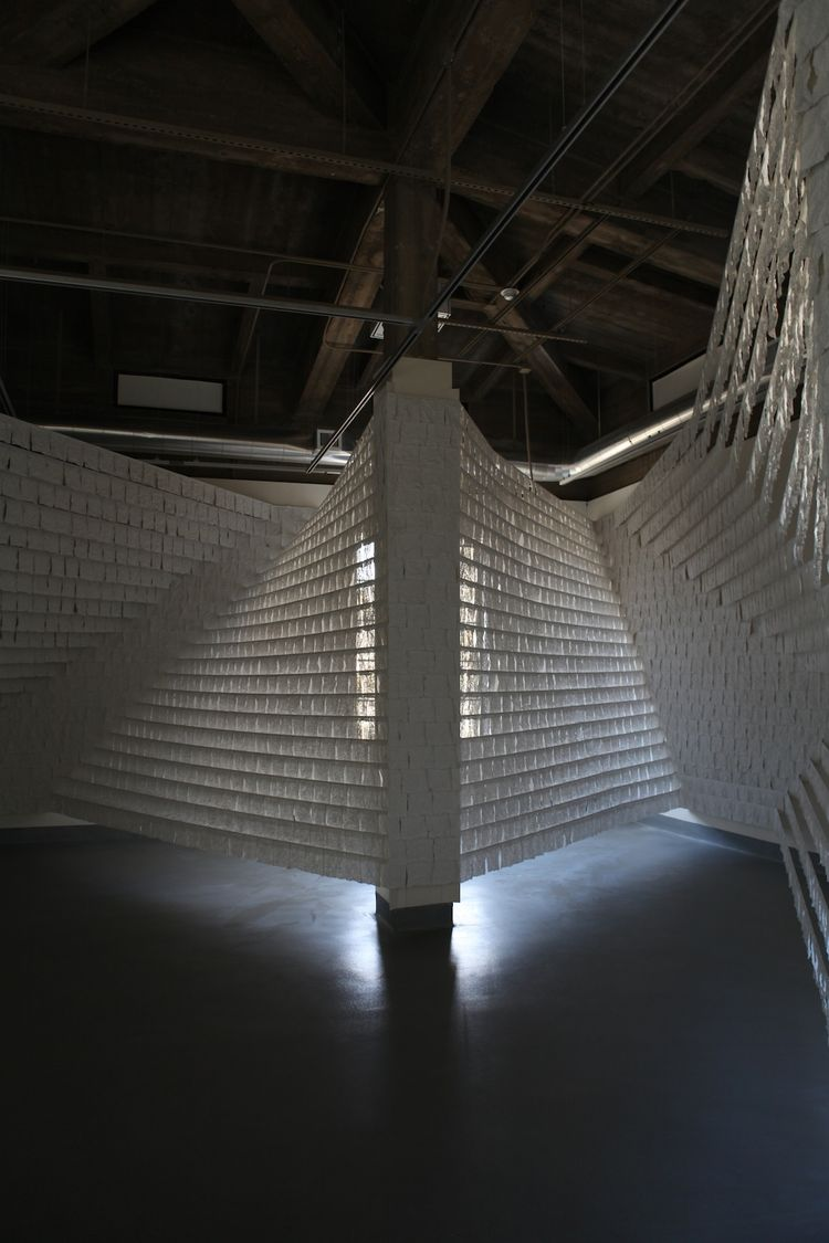 The installation consists of nine mirrors and thousands of plaster-impregnated pieces of cloth.