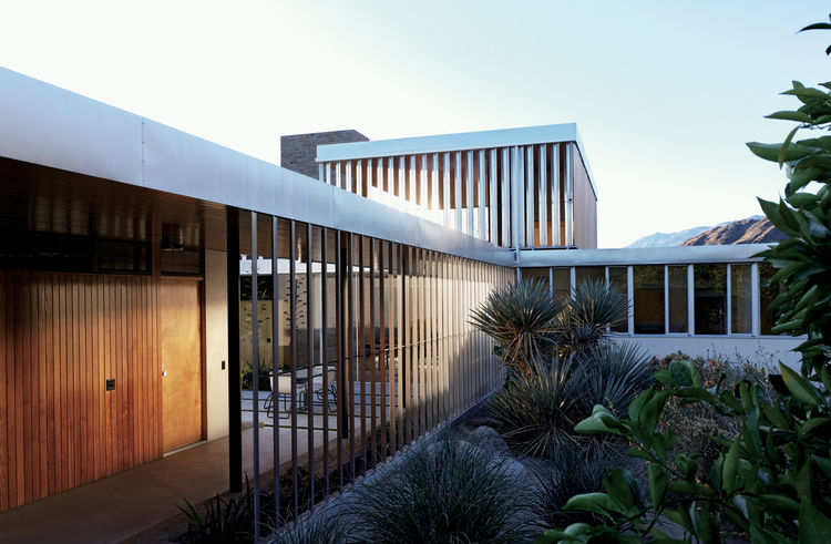 Here's another take on the Kaufmann House by Neutra, the vertical lines serving as a nice counterpoint to the linear quality of the house. Photo by Raymond Meier.