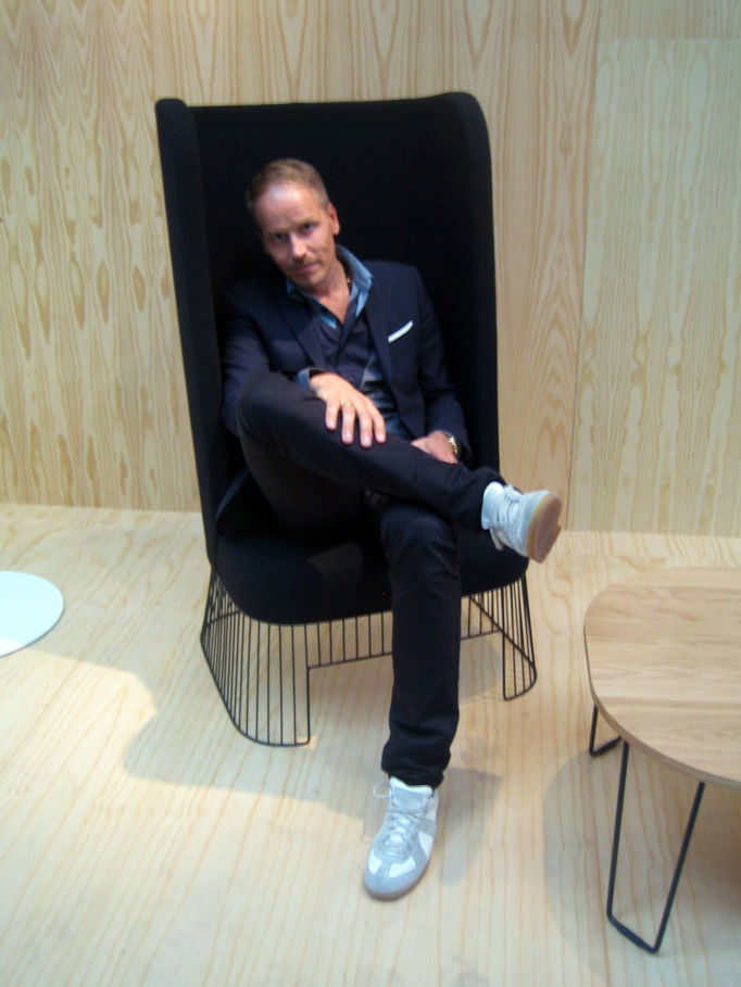 "Danish designer <a href=""http://sorenrose.com/"">Søren Rose</a> poses in his PA Chair that is also from De La Espada. He told me that the base of the chair is modeled on the bases Verner Panton was designing in the 80s. A fine homage."
