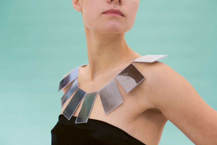 Lux necklace by Mae Yokoyama<br><br>Mae Yokoyama's necklace combines haute couture and high technology to highlight the benefits of solar energy. During the day, the solar panels create a bold collar necklace. At night, the energy accumulated during the d