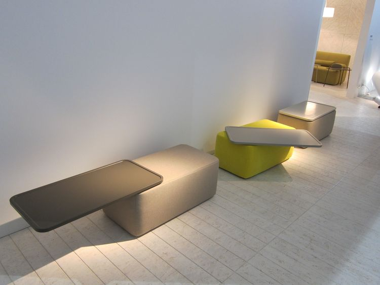 These Philippe Nigro side tables/ottomans transform, with a swivel of the tray-like top, into a place to sit.
