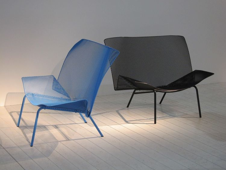 This is the elegantly folded Grillage outdoor chair by Francois Azambourg. The back has some good flex and bounce, so it's very comfortable.