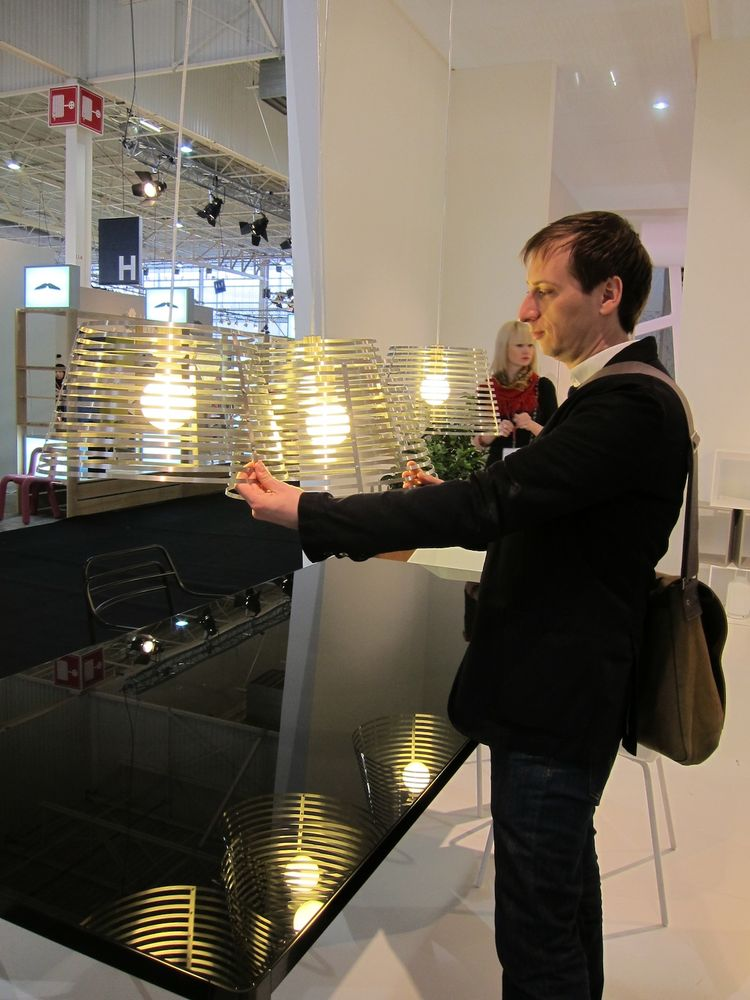 """Nigro demonstrates how his Stripes pendant lamps mesh together to form a """"composition of intersections."""""""