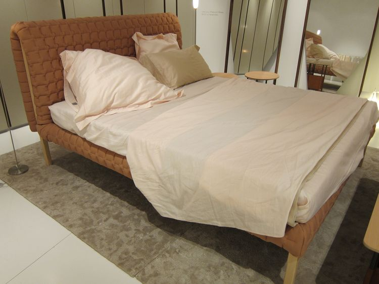 """The fabulous new Ruché bed by Inga Sempe, which can be made in almost any fabric and was exhibited in an orangey mauve. """"A beautiful bed, and a feminine one,"""" said Roset."""