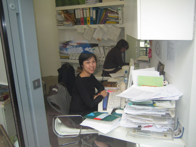 "I snapped this photo from the walkway up to the building. Tu Mong Edwards works in the office which she likened to ""a cupboard."" Cramped though it is, she notes that ""For a charity that focuses on cancer, it's amazing how much laughter echoes off the wall"