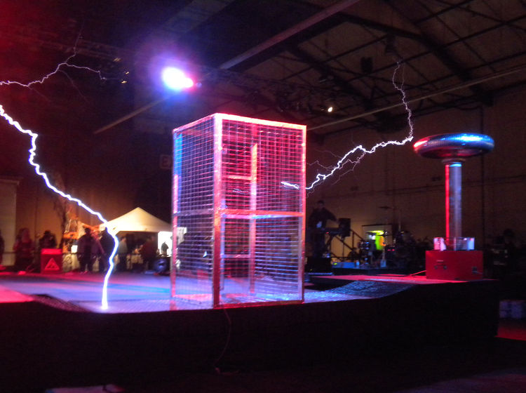 "The Fiesta Hall's main attraction was the Tesla Stage. Here, Austin-based group <a href=""http://www.arcattack.com/"">ArcAttack!</a> set up its Tesla coils and Faraday cage. The coils create electricity, which become electrical arcs, which look like lightni"