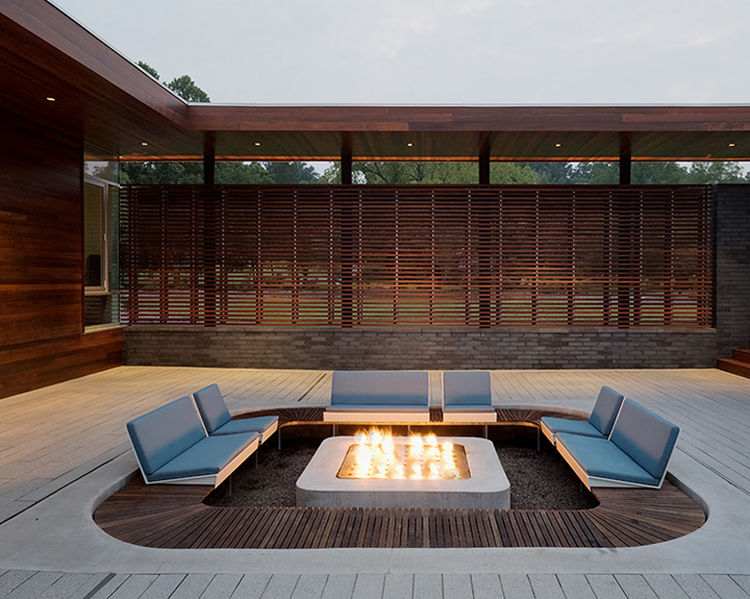 The Curved House in Springfield, Missouri, offers a cozy fire pit in an interior courtyard.