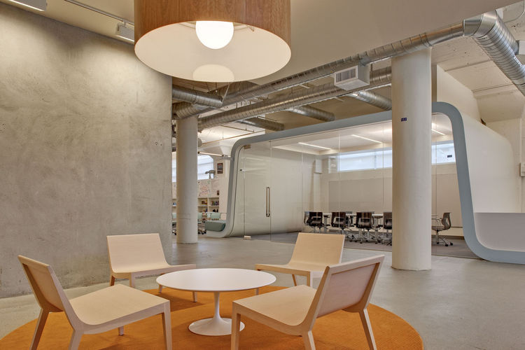 """The """"wavelike"""" structure that floats over the conference room, says the design team, """"symbolizes creative brainwaves washing up to shore."""""""