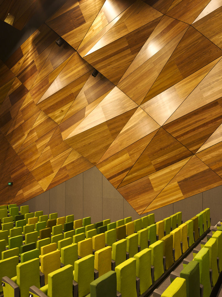 "The ""pineapple wall,"" so-called for its resemblance to the exterior of the fruit, on the interior of Plenary Hall (the main auditorium) mimics what's on the outside, and suggests a kind of building-within-a-building scheme for the Convention Center. Due t"